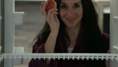 Woman taking apple from fridge Stock Footage