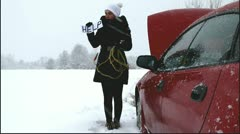 Cute girl needs help on the road - stock footage
