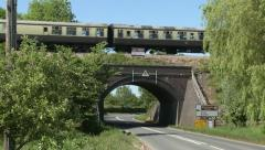 Steam Train & Carriages Passing Over a Bridge. Stock Footage
