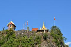 Temple on the moutain thong pha phom temple, kanchanaburi, thailand Stock Photos