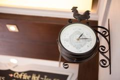 Old style hanging clock Stock Photos