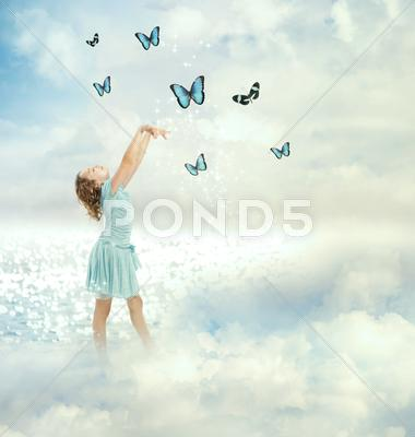 Stock photo of little girl with butterflies