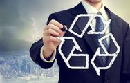 Businessman drawing recycle sign Stock Photos