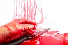 Halloween concept : hand in blood with knife  on a white background Stock Photos