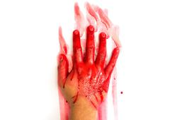 Halloween concept : hand in blood on a white background Stock Photos