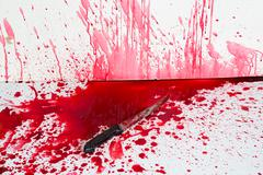 halloween concept : bloody knife with blood splatter - stock photo