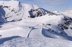 Ski run and hut in alps Stock Photos