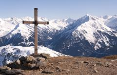 cross in alps - stock photo