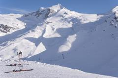 skis and hintertux glacier - stock photo