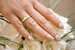 Wedding ring on a female hand Stock Photos