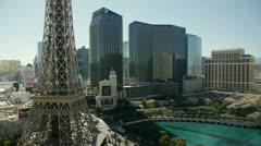View of Bellagio Fountains with Eiffel Tower and Cosmopolitan Hotel Stock Footage