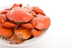 Steamed crabs on white plate Stock Photos