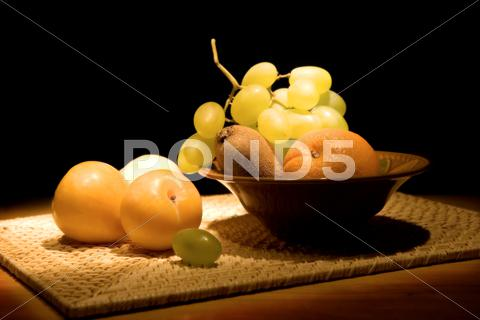 Stock photo of still-life with fruit in a vase