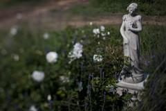 Garden statue of girl - stock photo