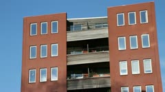 Smoke reflected on the windows of a red brick building - stock footage