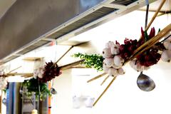 onion an garlic braid hanged in kitchen - stock photo