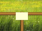 Stock Photo of sign on grass