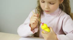 Baby girl paint the wooden figure toy. Fine Art How lesson-1 - stock footage