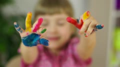 Funny girl coloring. Baby covered in paint Stock Footage