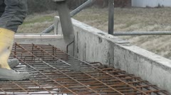 Bulider pouring a concrete foundation Stock Footage