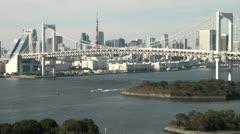 Rainbow bridge, infrastructure, Tokyo skyline, Japanese city Stock Footage