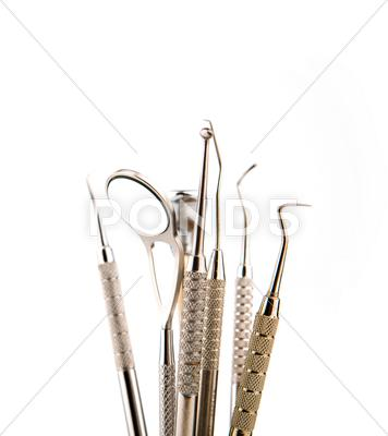 Stock photo of dental tools and equipment. over white background