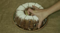 Hands take home made cake Stock Footage