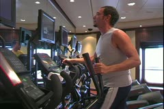 The Queen Mary 2, ocean liner, man in gym working out, aerobics Stock Footage