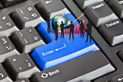 Stock Illustration of silhouettes of business with red graph and earth on enter keyboard (elements
