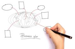 businessman drawing the world map of business plan  in a whiteboard - stock photo