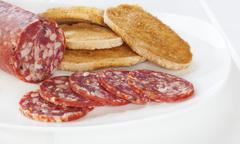 salami and toast on plate - stock photo