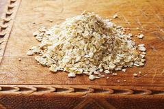 Stock Photo of oats on an old wooden board