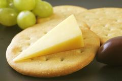 Cheddar cheese and crackers Stock Photos