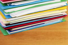 Stack of files on wood surface horizontal Stock Photos