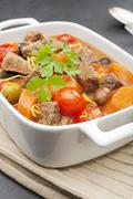 Beef stew with olives Stock Photos