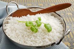 Basmati rice and coriander Stock Photos