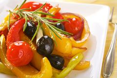 Spanish baked peppers and tomatoes Stock Photos