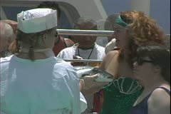 The Queen Mary 2, ocean liner, Court of King Neptune, kissing the fish Stock Footage