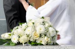 Bridal bouquet and wed couple Stock Photos