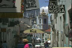 Salvador de Bahia, Brazil, busy street with baroque church in background Stock Footage