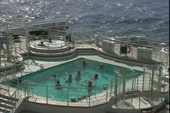 The Queen Mary 2, ocean liner, decks, at sea, close up of the swimming pool Stock Footage