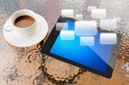 Digital tablet and cup of coffee on work table Stock Illustration