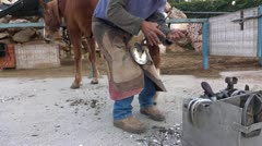A farrier equine hoof  - shoeing horse - stock footage