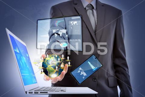 Stock Illustration of business man with laptop,mobile phone,touch screen device  (elements of this
