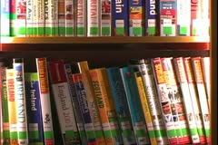 The Queen Mary 2, ocean liner, library, close up of book spines Stock Footage