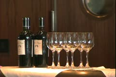 The Queen Mary 2, ocean liner, wine bottles and wine glasses Stock Footage