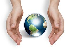 two hands with earth  (elements of this image furnished by nasa) - stock photo