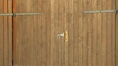 Robber trying to break the garage door Stock Footage