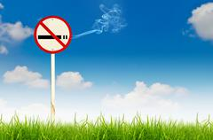 no smoking sign on fresh spring green grass - stock photo