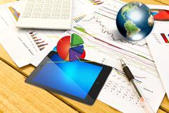 Touch pad and financial graphs Stock Photos